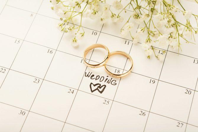 Word wedding on calendar with sweet flowers